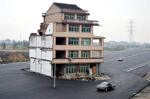Motorway built around the house of a Chinese Farmer