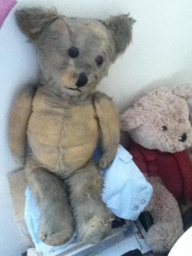 I spend a few moments before the funeral with Mams old teddy circa 1950.  Very worn from a lifetime of cuddles and greatly loved.  You can just see the stitching on top of his head when he was burnt by a piece of coal that spat out of the fire.  He was repaired by my Grandad about 60 years ago.