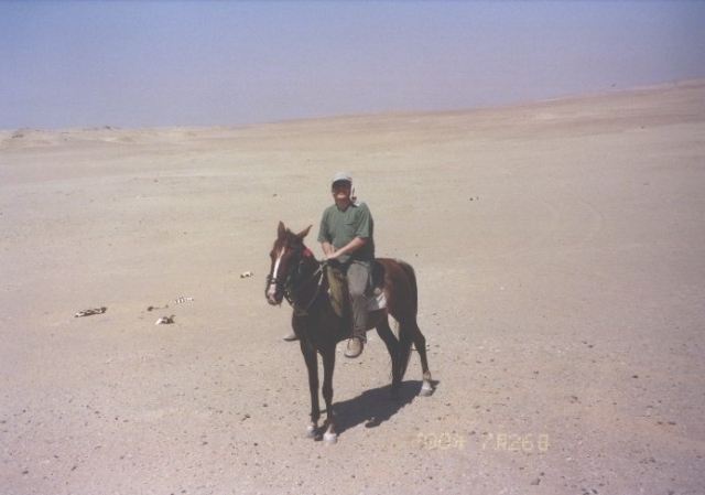 Stephen Liddell riding through the desert.