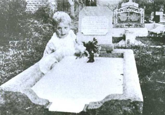 Child by grave