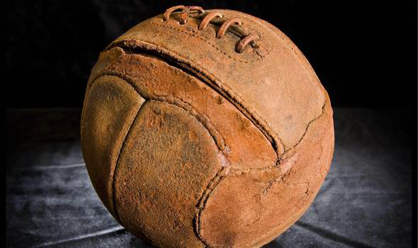 Football from WW1 with barbed wire holes in it.