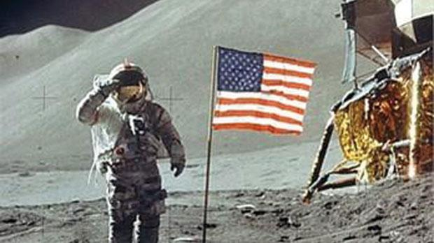 Neil Armstrong salutes the flag.