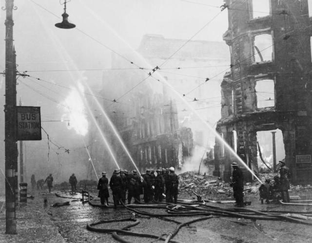 Firemen in Manchester tackle the aftermaths of a bombing raid