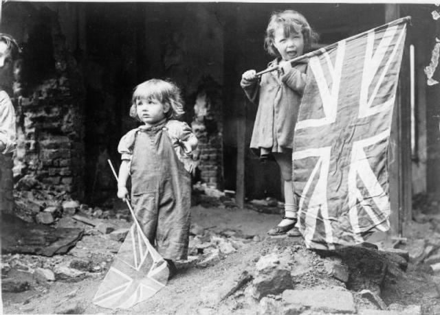 Two little girls in the bombed out area of Battersea, London