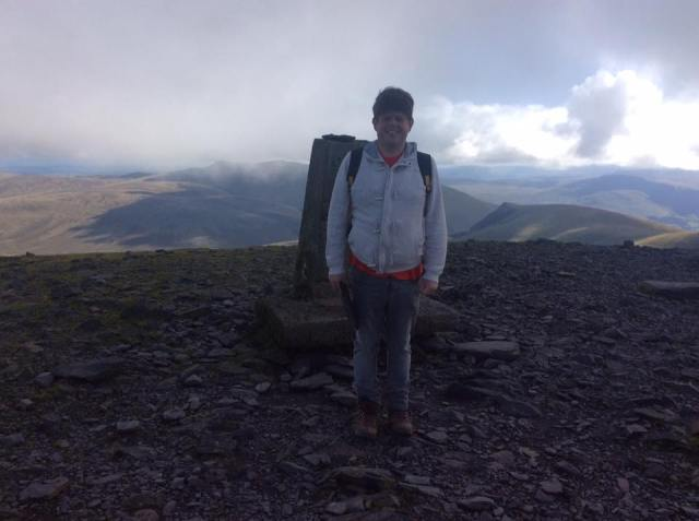 Me on top of Skiddaw... right photo taken, lets find someplace to eat!