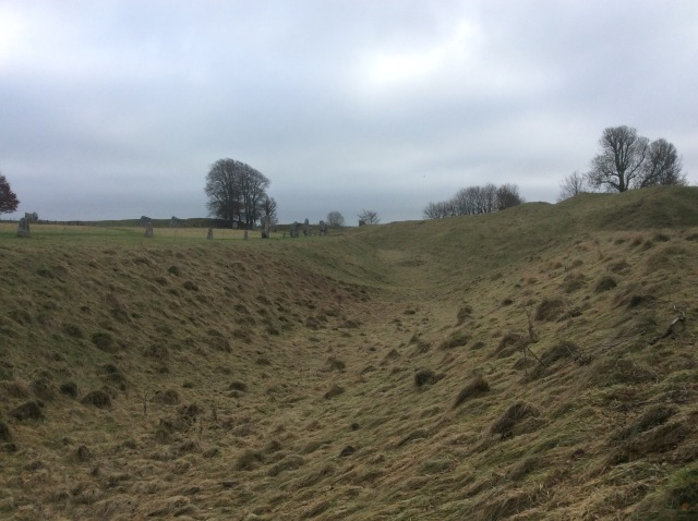 The outer ditch and earthen heap that encircles the mile wide Avebury Stone-circle