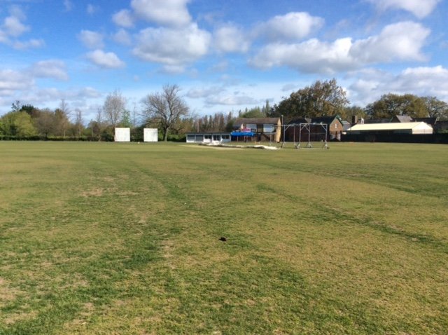 The village cricket ground. The field is still quite lush but you can see the area where the wickets will go is already rock hard and flat.