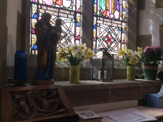 The church is beautifully decorated with a variety of spring time flowers on all the windows and pillars.