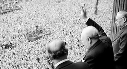 PM Sir Winston Churchill giving one of his many V gestures to the assembled crowds.