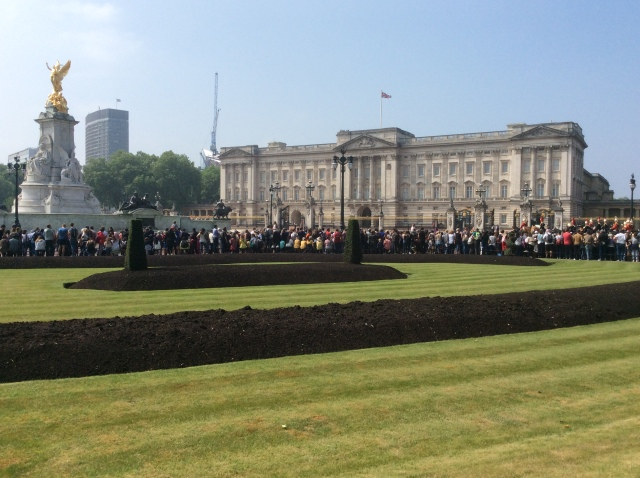 Crowds assemble outside Buckingham Palace
