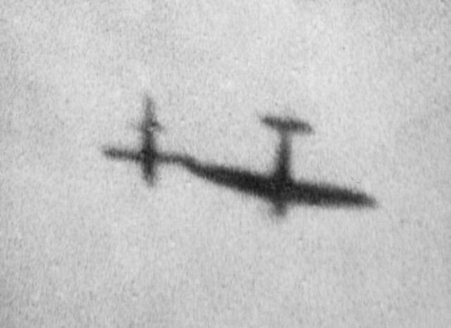 V1 flying bomb being wing tipped CROWN COPYRIGHT