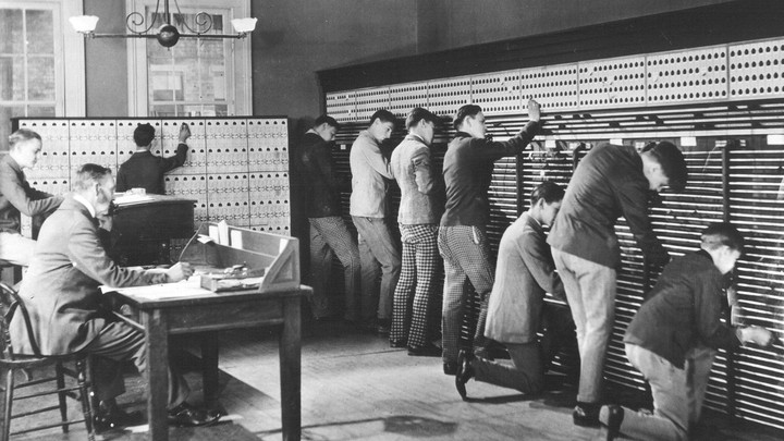 Teenage boys operating a 19th century switchboard.