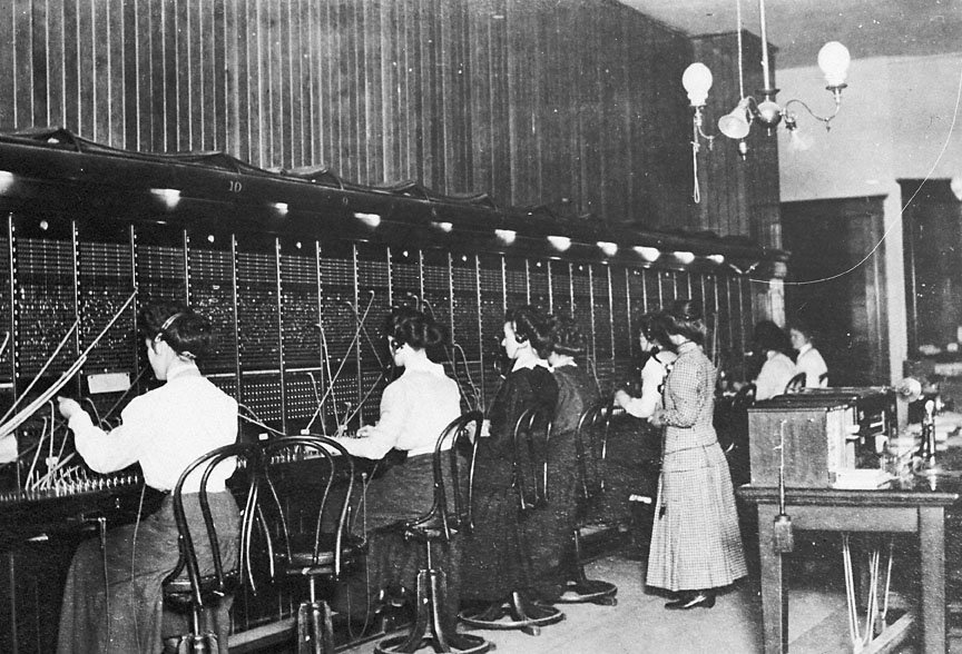 Some early lady telephone switchboard operators.